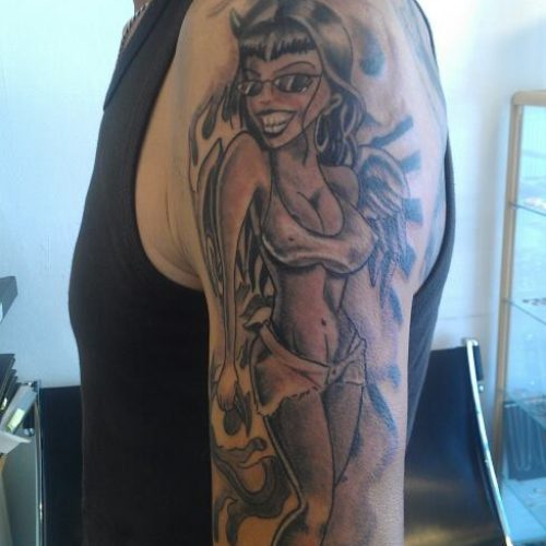 Chicano lady devil player style tattoo tatovering