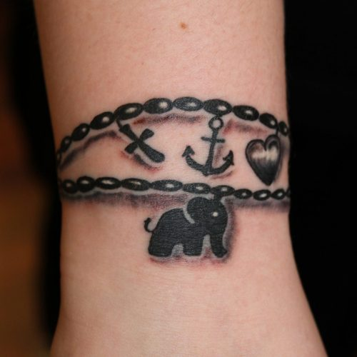 armbånd med charms tatovering tattoo bracelet
