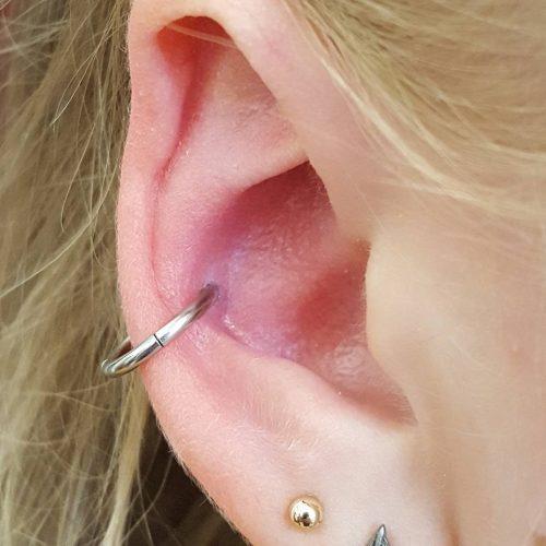 Conch piercing cartilage brusk piercing unisex segment ring